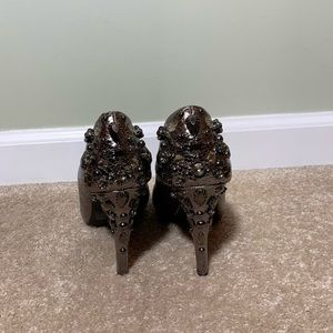Snakeskin heels with bling